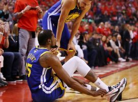 Kevin Durant of the Golden State Warriors falls to the court after re-injuring his lower leg in Game 5 of the NBA Finals against the Toronto Raptors in Toronto, Canada. (Image: Gregory Shamus/Getty)