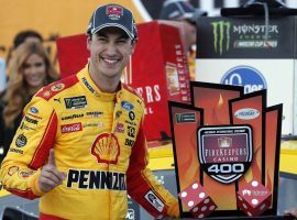Joey Logano jumped out to the lead on a late restart to win on Monday at Michigan International Speedway. (Image: Carlos Osorio/AP)