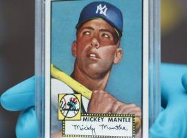 Mickey Mantle's baseball card issued by Topps in 1952 is one of the all-time sellers. (Image: David Zalubowski/AP)