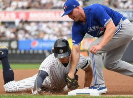 NY Yankees outfielder Giancarlo Stanton injured his knee while sliding into third base against the Blue Jays at Yankee Stadium. (Image: Kathleen Malone-Van Dyke/Newsday)