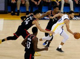 Steph Curry of the Golden State Warriors splits through multiple defenders on the Toronto Raptors during Game 3 of the NBA Finals at Oracle Arena in Oakland. (Image: Lachlan Cunningham/Getty)