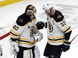 Bruins' goalie Tuukka Rask is congratulated by teammate Zdeno Chara after winning Game 6 of the Stanley Cup Finals in St. Louis. (Image: Getty)