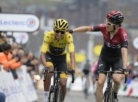 Geraint Thomas (right) congratulates teammate Egan Bernal (left) on retaining the yellow jersey and locking up a victory in the 2019 Tour de France as they cross the finish line at Stage 20 in Val Thorens. (Image: Sunada)