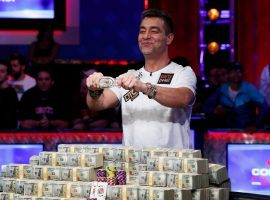Germany's Hossein Ensan poses with his bracelet and his $10 million in prize money after winning the 2019 World Series of Poker main event.