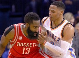 Ex-Oklahoma City Thunder guard Russell Westbrook (right) guards James Harden of the Houston Rockets during a 2018 game in Oklahoma City. (Image: Alonzo Adams/AP)