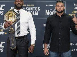 Jon Jones (left) will defend his light heavyweight title against Thiago Santos at UFC 239 on Saturday. (Image: MMAFighting.com)