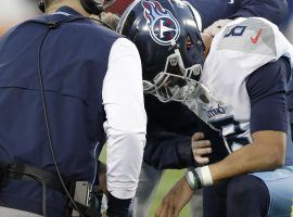 NFL QB Marcus Mariotta knocked unconscious in 2018 regular season game. (Image: AP/James Kenney)