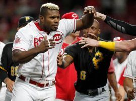 Teammates from the Cincinnati Reds try to restrain Yasiel Puig during a brawl against the Pittsburgh Pirates in Cincinnati. (Image: Getty)