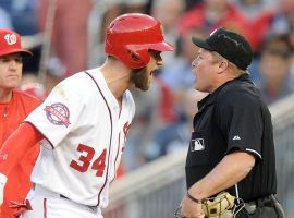 MLB hitter Bryce Harper argues a strike call with non-robot umpire