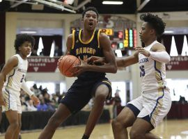 Evan Mobley (4) of Rancho Christian playing against McEachern (Georgia) in a high school prep tournament. (Image: Gregory Payan/AP)