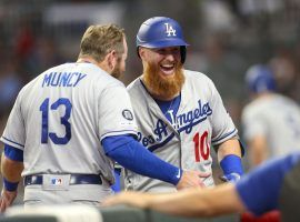 LA Dodgers 2B Max Muncy congratulates 3B Justin Turner after a victory over the Atlanta Braves. (Image: Brett Davis/USA Today Sports)