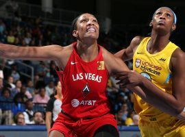 A'ja Wilson (left) came back from injury to lead the Las Vegas Aces to a win over Chicago on Sunday, a victory that clinch a playoff berth for the team. (Image: Gary Dineen/NBAE/Getty)