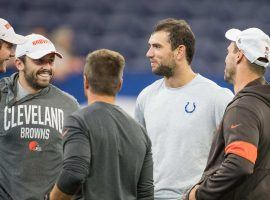 Indianapolis Colts QB Andrew Luck (center) chats with Cleveland Browns players and coaches during warmups of a preseason game. (Image: Trevor Ruszkowski/USA Today Sports)