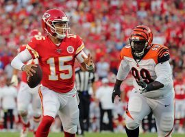 KC Chiefs QB Patrick Mahomes evades a defender during a preseason game against the Bengals. (Image: Jay Biggerstaff/USA Today Sports)