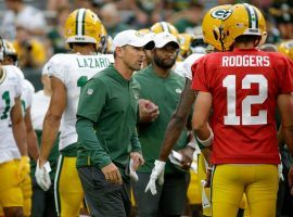 New head coach Matt LeFluer chats with QB Aaron Rodgers at the Green Bay Packers training camp. (Image: Matt Roemer/AP)