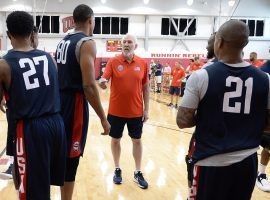 Team USA head coach Gregg Popovich chats with players during a practice in Las Vegas. (Image: Getty)