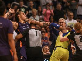 Brittney Griner (left) was suspended three games for her role in a brawl between the WNBA's Phoenix Mercury and Dallas Wings on Saturday. (Image: Madeleine Cook/Arizona Republic)