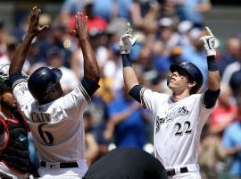 Lorenzo Cain of the Milwaukee Brewers congratulates Christian Yelich after a home run at Miller Park. (Image: Dylan Buell/Getty)