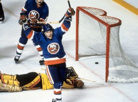 Where the turf meets the ice. Iconic moments like Mike Boy Hall of Fame sniper, who racked up 64 goals during the regular season and 17 more in the playoffs, terrorized the Canucks with seven in the Islanders' sweep of the series. Here, the 1982 playoff MVP exults after beating Vancouver goalie Richard Brodeur for one of his two power play tallies in the Isles' 3-1 win in Game 4 that made them the first U.S.-based team to win three consecutive Stanley Cups.