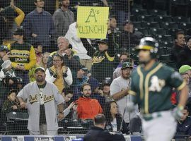 Oakland A's fans celebrate their team advancing to the AL Wild Card for a second consecutive year. (Image: Ted S. Warren/AP)