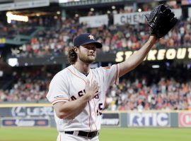 Houston Astros pitcher Gerrit Cole acknowledges the crowd after recording his 300 th strikeout of the season. (Image: Michael Wyke/AP)