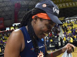 Jonquel Jones celebrates after the Connecticut Sun clinched a spot in the WNBA Finals on Sunday. (Image: Andrew D. Bernstein/NBAE/Getty)