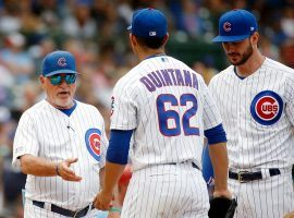 Chicago Cubs manager Joe Maddon takes the ball from relief pitcher Jose Quintana at Wrigley Field. (Image: Jon Durr/USA Today Sports)