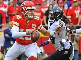 Kansas City QB Patrick Mahomes evades a blitzer in a Chiefs victory over the Baltimore Ravens at Arrowhead Stadium. (Image: Jamie Squire/Getty)