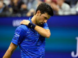 Already down two sets and a break, Novak Djokovic retired from his fourth-round US Open match vs. Stan Wawrinka due to a shoulder injury. (Image: Reuters)