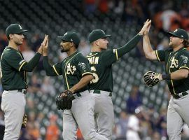 The Oakland A's celebrate a big win over the Astros in Houston. (Image: Tim Warner/Getty)