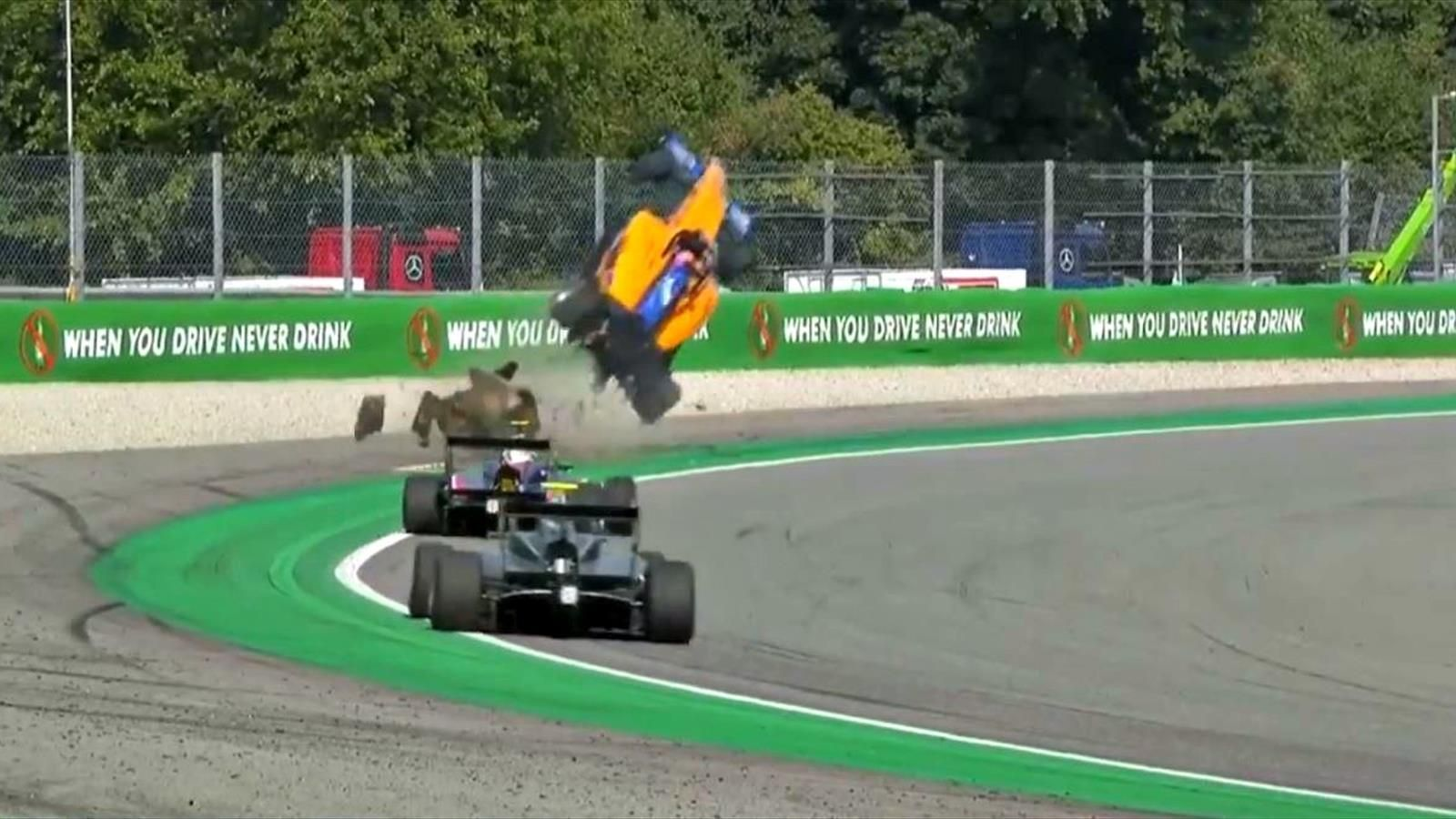 Sausage curb flips Alex Peroni's Formula car