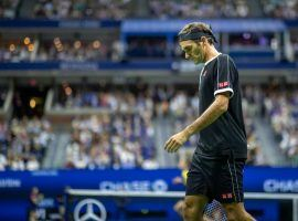 Roger Federer struggled with upper back and neck pain before losing in five sets to Grigor Dimitrov in the US Open quarterfinals on Tuesday. (Image: Tim Clayton/Corbis/Getty)