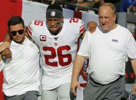 New York Giants medical staff assist Saquon Barkley to the locker room after he injured his ankle against the Tampa Bay Bucs in Week 3. (Image: Mark LoMoglio/AP)