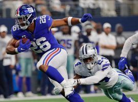 NY Giants RB Saquon Barkley evades a tackler in a Week 1 loss to the Dallas Cowboys. (Image: Porter Lambert/Getty)