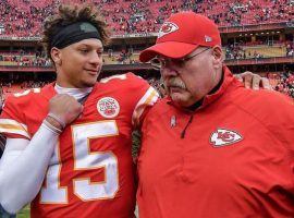 Chiefs QB Patrick Mahomes and head coach Andy Reid chat after a playoff game at Arrowhead Stadium in Kansas City. (Image: John Sleezer/AP)