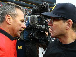 Could Michigan pull the ultimate switch-a-roo and hire Urban Meyer? (Image: Sporting News)