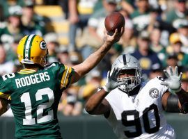 Green Bay QB Aaron Rodgers attacks the Oakland Raiders defense during a victory at Lambeau Field in Green Bay, WI. (Image: Jeffrey Phelps/AP)