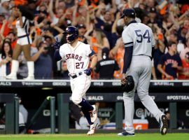 Houston Astros 2B Jose Altuve rounds the bases after hitting a walk-off home run off NY Yankees pitcher Aroldis Chapman (right) to win the 2019 ALCS. (Image: Elsa/Getty)