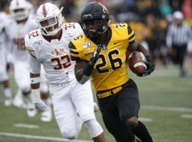 Appalachian State RB Marcus Williams Jr. escapes from a Louisiana Monroe defender during a blowout victory in Boone, NC. (Image: Brian Blanco/AP)