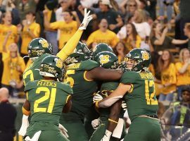 The Baylor Bears celebrate a touchdown in double overtime against Texas Tech in Waco, TX. (Image: Jerry Larson/AP)