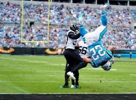 Carolina Panthers RB Christian McCaffrey flips into the end zone in a win over the Jacksonville Jaguars. (Image: Jacob Kupferman/Getty)