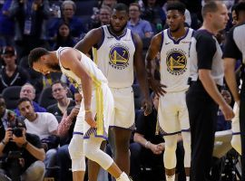 Golden State Warriors All-Star Steph Curry reacts to a broken left hand during a game against the Phoenix Suns in San Francisco, CA. (Image: Ben Margot/AP)