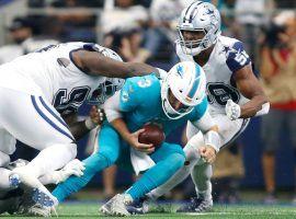 The Dallas Cowboys swarm Miami Dolphins QB Josh Rosen. (Image: Tim Heitman/USA Today Sports)