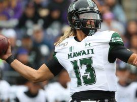 Hawaii quarterback Cole McDonald drops back to pass against Washington at Husky Stadium in Seattle, WA. (Image: Abbie Parr/Getty)
