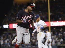 An enthusiastic Washington Nationals 2B Howie Kendrick rounds the bases after hitting a grand slam in extra innings to eliminate the LA Dodgers in Game 5 of the 2019 NLDS at Dodger Stadium. (Image: Marcio Jose Garcia/AP)