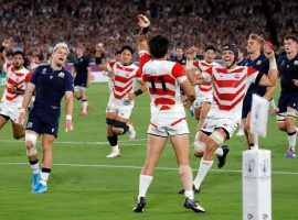 Japan celebrated making its first Rugby World Cup quarterfinal after defeating Scotland in its final group stage match. (Image: AP)