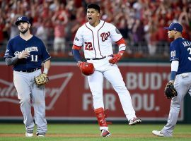Washington Nationals OF Juan Soto celebrates after a bases-clearing RBI single but the Nats ahead of the Milwaukee Brewers in the 2019 NL Wild Card. (Image: Getty)