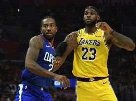 LA Clippers forward Kawhi Leonard guards LA Lakers forward LeBron James on opening night at Staples Center in Los Angeles. (Image: Sandy Hooper/USA Today Sports)