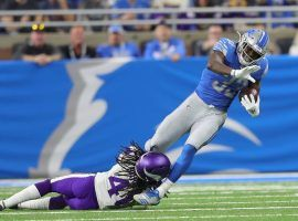 Detroit Lions RB Kerryon Johnson tries to evade a tackler from the Minnesota Vikings in Week 7. (Image: Kirthmon F. Dozier/Detroit Free Press)
