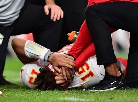 Kansas City Quarterback Patrick Mahomes goes down with an injured right knee against the Denver Broncos in Denver, CO. (Image: Ron Chenoy/USA Today Sports)